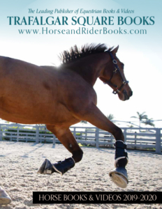 Horse galloping in arena cover of horse book catalog