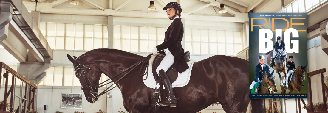 girl on horse dressage indoor arena